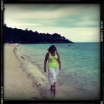 Mandi casually walking down the beach...